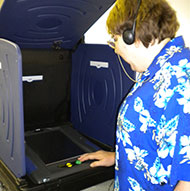 Nancy Ward using the iVotronic Voting Machine